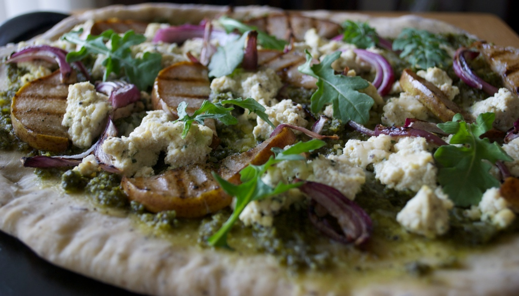 Grilled Pear Pizza: Bail Pesto, Tofu Ricotta, Red Onion on Herbed Crust.