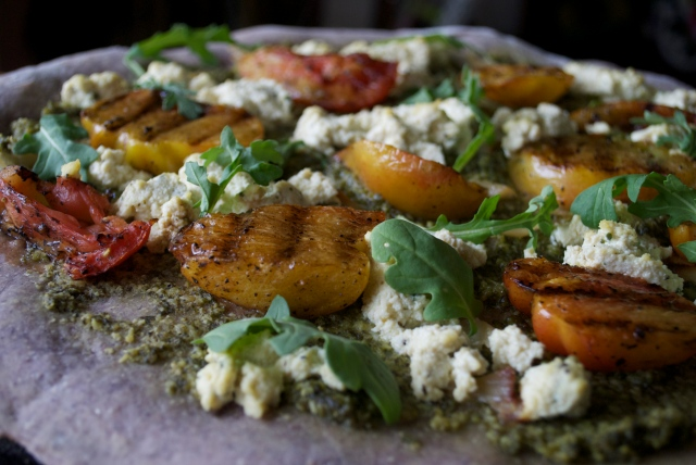 Grilled Heirloom Tomato Pizza: Basil Pesto, Tofu Ricotta, Wild Arugula on Blue Corn Crust.