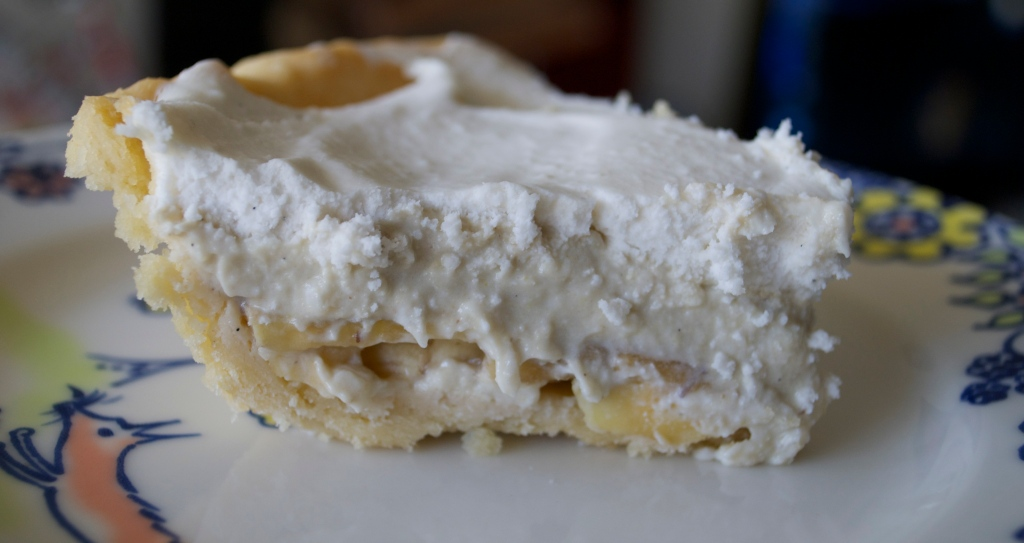 Homemade Short Crust--Layer of Apple Banana-Layer of Apple Banana Custard-Topped with Homemade Coconut Whipped Cream.