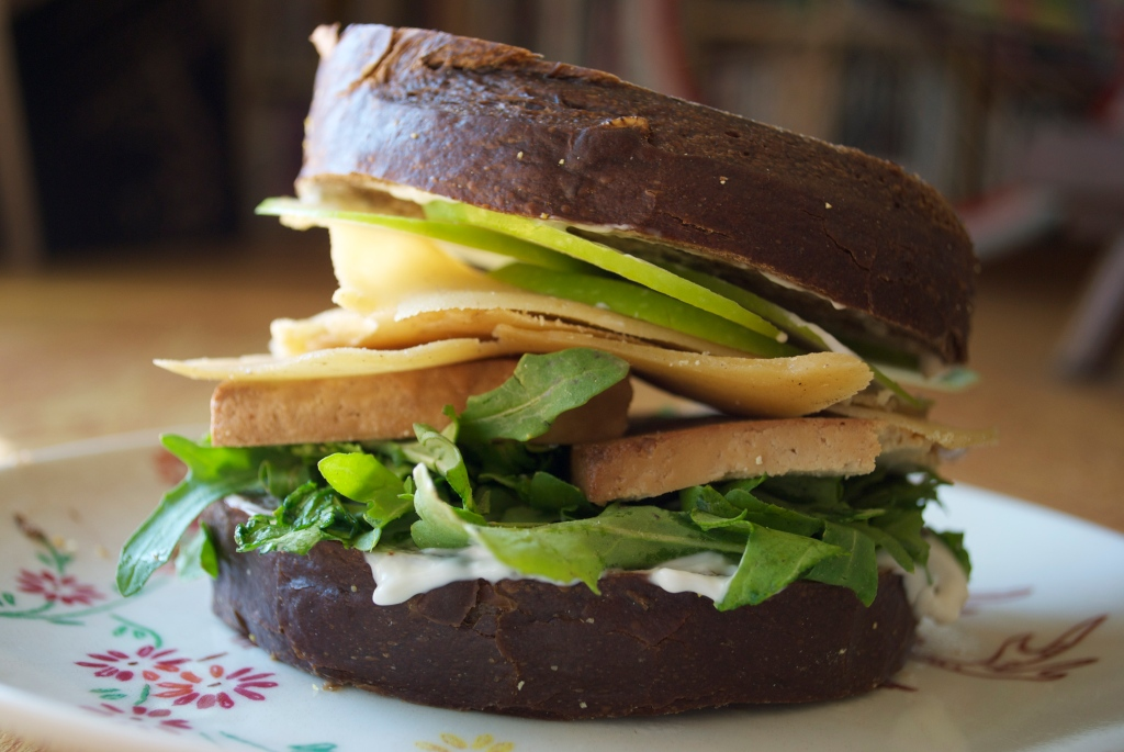 World's Best Sandwich: Green Apples, Smoked Tofu, Homemade vegan Gouda, Greens, Vegenaise, fresh Pumpernickel Bread.