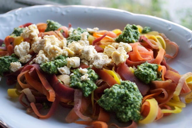 Blanched Rainbow Carrot Ribbons w/ Pesto & Tofu Goat Cheese Crumbles.