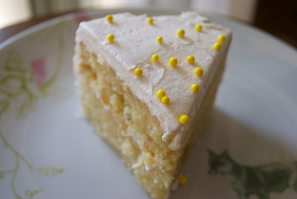 The cake is filled with buttercream mixed with vegan homemade lilikoi curd.