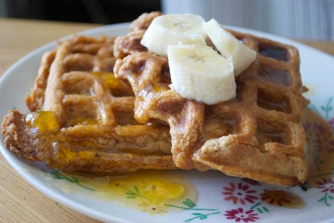 Papaya Waffles w/ Bananas, Lilikoi Syrup & Maple Syrup.